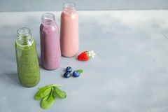 Variaties of Fresh and Cold Smoothies in Bottles Royalty Free Stock Photos