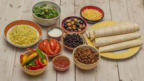 Variation av ingredienser som gör mexikanska burritos Fotografering för Bildbyråer