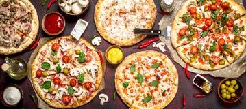 variation av pizza med såser fotografering för bildbyråer