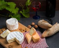 Variation of cheese and wine and bread Royalty Free Stock Photos