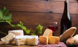 Variation of cheese and wine and bread Royalty Free Stock Image