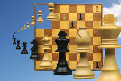 Variation on a chess game. With pieces and chessboard Royalty Free Stock Image