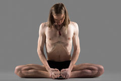 Variation of cobbler yoga pose Royalty Free Stock Photography