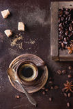 Variation of coffee beans. Green and brown decaf unroasted and black roasted coffee beans with spices and sugar in old wooden box, and ceramic cup of fresh stock photos