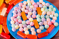 Variation of colorful hard candy lying on blue plate Royalty Free Stock Photo