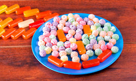 Variation of colorful hard candy lying on blue plate Royalty Free Stock Image