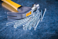 Variation of construction nails with claw hammer Stock Photos