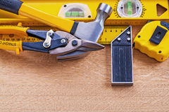 Variation of construction tools on wooden Royalty Free Stock Image