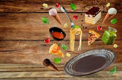 The variation of the flying Italian food and a brown plate on a Stock Images