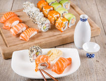 Variation of fresh tasty sushi rolls Stock Images