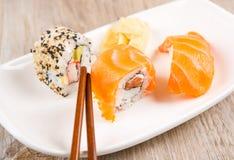 Variation of fresh tasty sushi rolls Stock Photo