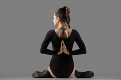 Variation of Gomukhasana yoga pose Royalty Free Stock Image