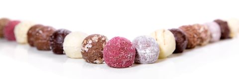 Variation of gourmet chocolate truffles or pralines on white background, header royalty free stock photos