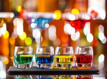 Variation of hard alcoholic shots on bar counter Stock Photography