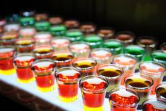 Variation of hard alcoholic shots served on bar counter. stock image