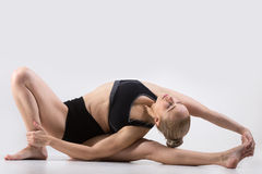 Variation of Head-to-Knee forward bend pose Stock Photos