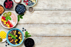 Variation of healthy smoothie breakfast bowls with berries, fruits and nuts. Toning. selective focus royalty free stock photo