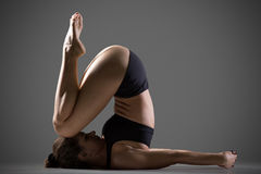 Variation of Knee to Ear Yoga Pose Stock Photos