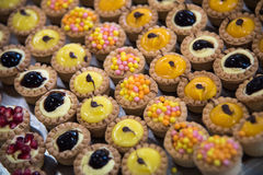 Variation of pastry decorated with various fruits Royalty Free Stock Image