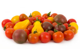 Variation of tomatoes. Variation of miniature tomatoes over white stock image