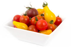 Variation of tomatoes. Variation of miniature tomatoes over white royalty free stock images