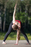 Variation of Trikonasana Pose Royalty Free Stock Image