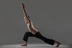 Variation of virabhadrasana 1 yoga pose Royalty Free Stock Images