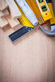 Variation of working building tools on wooden Royalty Free Stock Photo