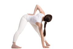 Variation of Yoga Triangle pose Royalty Free Stock Photos