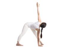 Variation of Yoga trikonasana pose Royalty Free Stock Photo