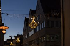 Variations on a lustre at christmas market blue hour Royalty Free Stock Photo