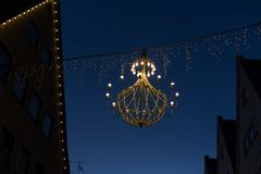 Variations on a lustre at christmas market blue hour Royalty Free Stock Images