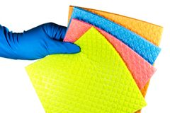 Variaty of cellulose sponge cloth in the cleaner`s rubber gloved hand, isolated on white background.  royalty free stock images