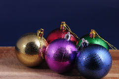 Varicolored balls ,christmas toys. Over dark blue background stock image