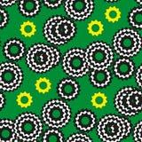 Varicolored cogwheels на зеленой предпосылке Стоковое Фото