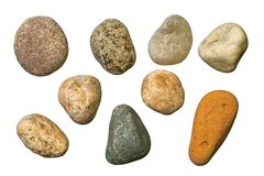 Varicolored gravel stones. Varicolored granite, quartz and sand-rock round gravel stones. Isolated objects on a white background Royalty Free Stock Photography