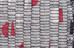 Varicolored knitted carpet background Stock Images