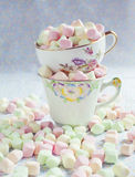 Varicolored marshmallows in antique cups. Stock Images