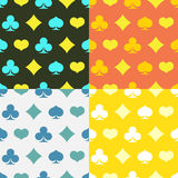 Varicolored set of seamless patterns with suits of cards. Set of seamless patterns with suits of cards Stock Image