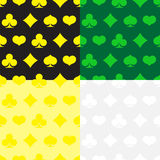 Varicolored set of seamless patterns with suits of cards Stock Photos
