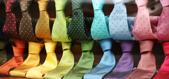 Varicolored Ties in a shopwindow. Two rows of varicolored silk neckties in a shopwindow Stock Photos