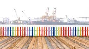 Varicolored wooden fence and floor wood with cargo ship backgro royalty free stock photos