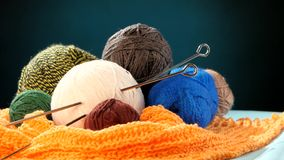 Varicolored yarn balls with spokes on orange scarf stock video