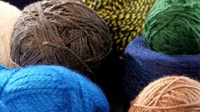 Varicolored yarn balls with spokes, rotation stock video