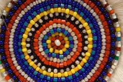 Varicoloured beads. Mosaic of beads make their hands Stock Photo