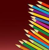 Varicoloured Bleistifte auf einem Rotweinhintergrund stock abbildung