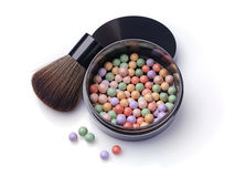 Varicoloured blush balls in black container and brush for makeup Stock Photography