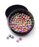 Varicoloured blush balls in black container Stock Photos