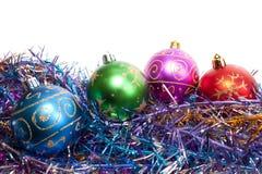 Varicoloured Christmas balls. New-year decorations. Varicoloured Christmas balls and tinsel on a white background Royalty Free Stock Photo