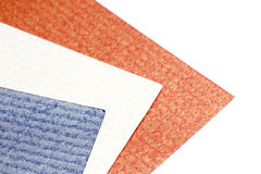 Varicoloured designer cardboards on a white. Red dark blue and white designer cardboards on a white background Royalty Free Stock Photos